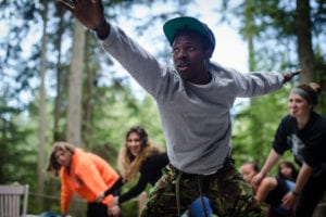 A camper participates in a group activity at Partners for Youth's Power of Hope Camp